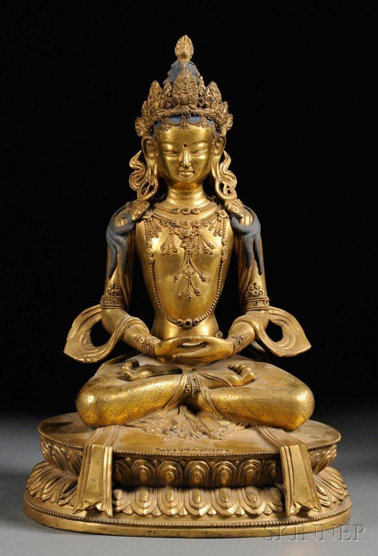 Gilt-bronze Figure, Sino-Tibetan, depicting Buddha seat