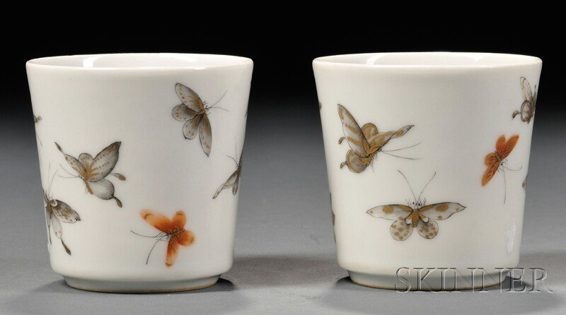 Pair of Famille Rose Cups, China, decorated with butter
