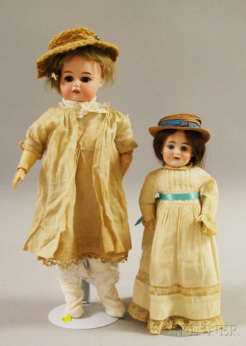 14: Two German Bisque Head Dolls, one in white and a 12