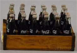 287 Miniature Set of Twentyfour CocaCola Glass Bottl