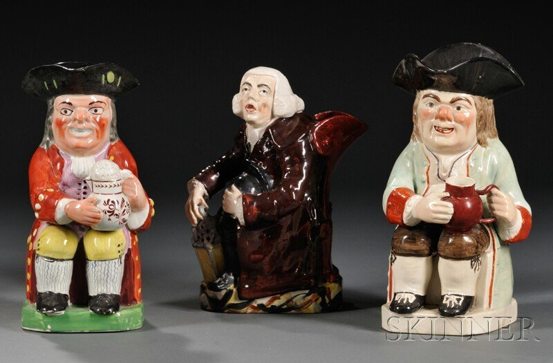 4: Three Staffordshire Pottery Toby Jugs, England, firs