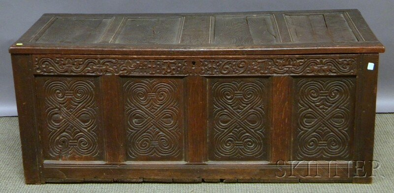 615: Carved Oak Paneled Joined Chest, with carved front