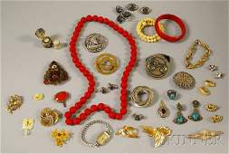 223: Small Group of Costume Jewelry, including a carved