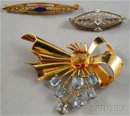 269: Three 14kt Gold Gem-set Brooches, a ribbon brooch
