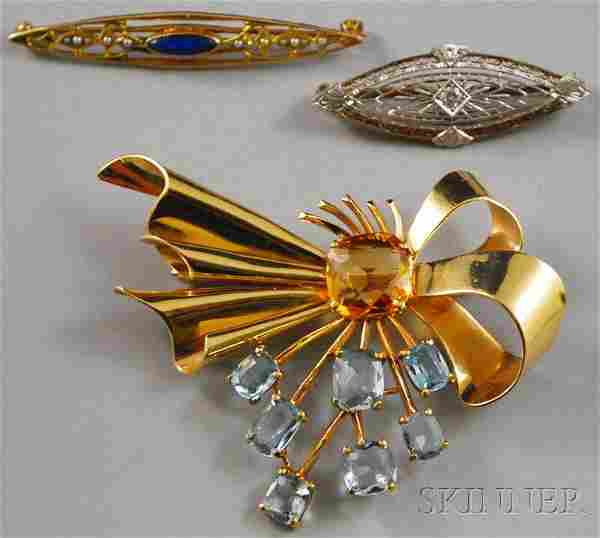 Three 14kt Gold Gem-set Brooches, a ribbon brooch