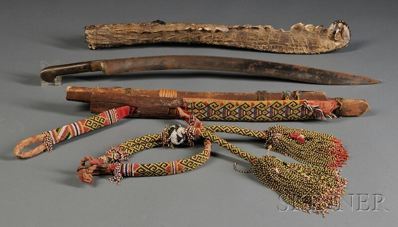 18: Two Indonesian Sword Scabbards, one with sword, the