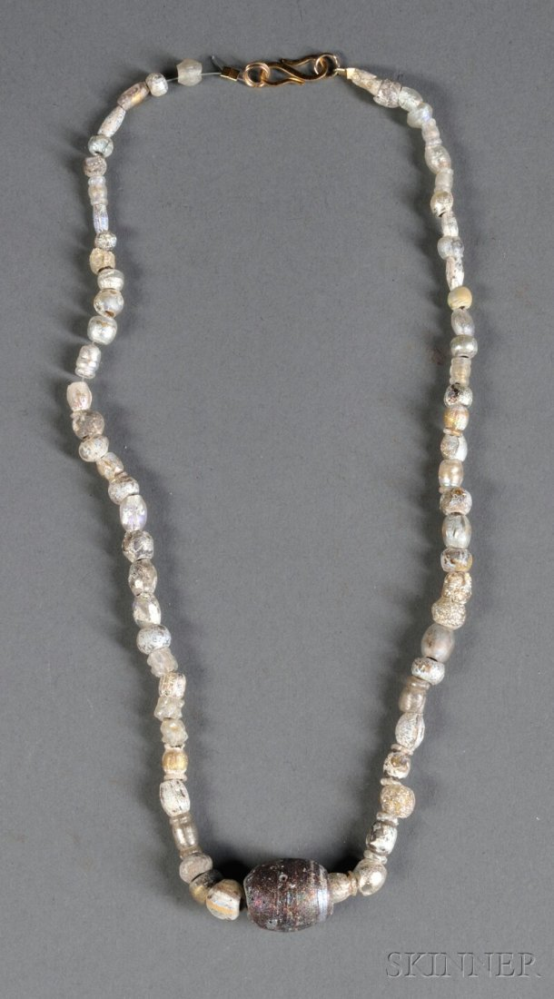 17: Glass Bead Necklace, c. 1st millennium B.C., compri