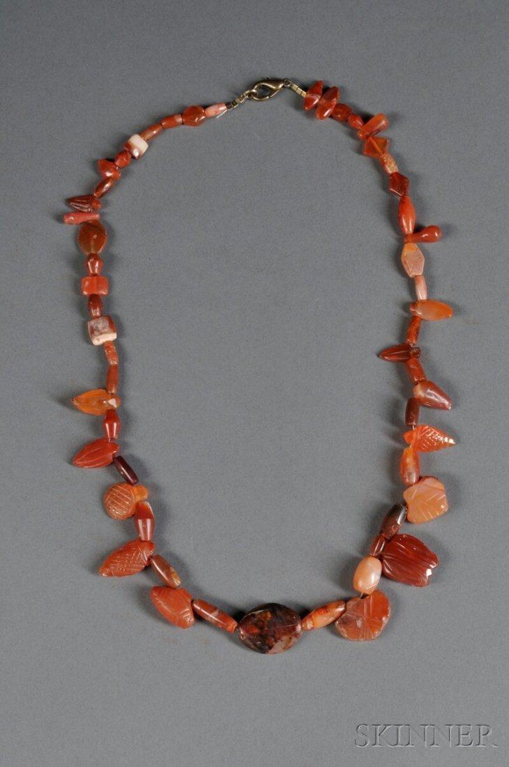 19: Red Stone Necklace, c. 1st millennium B.C., consist