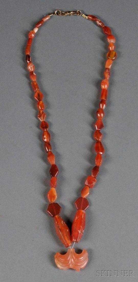 20: Red Stone Necklace, c. 1st millennium B.C., compris