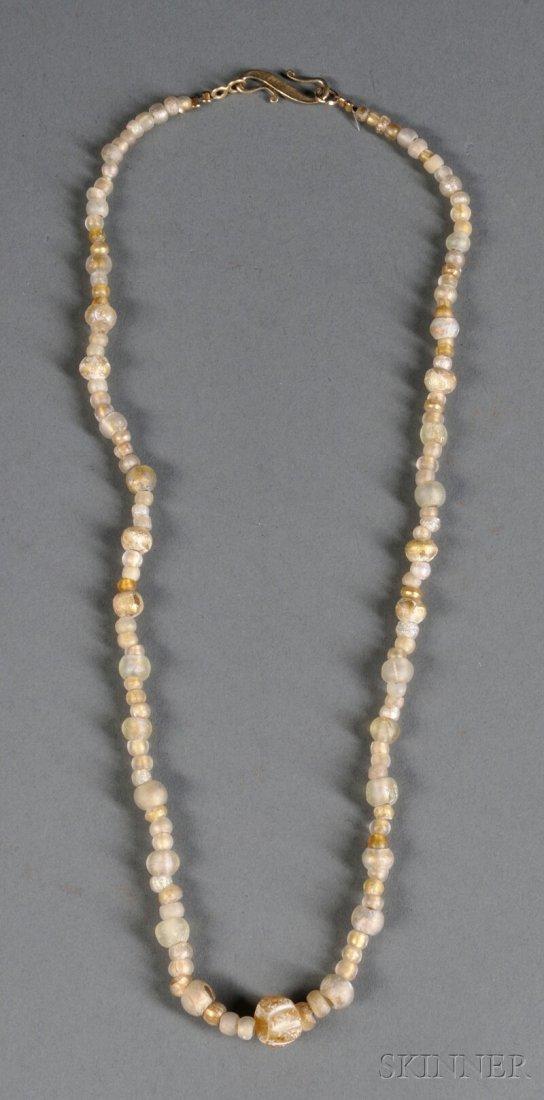 21: Glass Bead Necklace, c. 1st millennium, each bead o