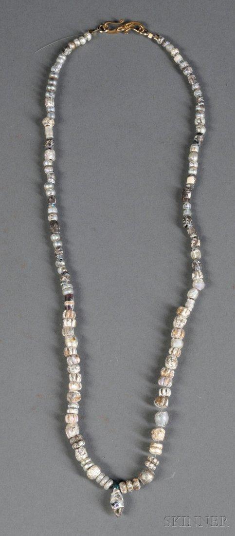 22: Glass Bead Necklace, c. 1st millennium, of compress