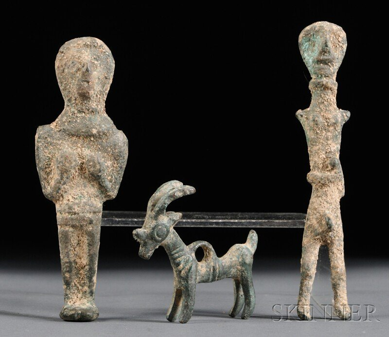 23: Three Bronze Figures, possibly Egypt, an antelope a