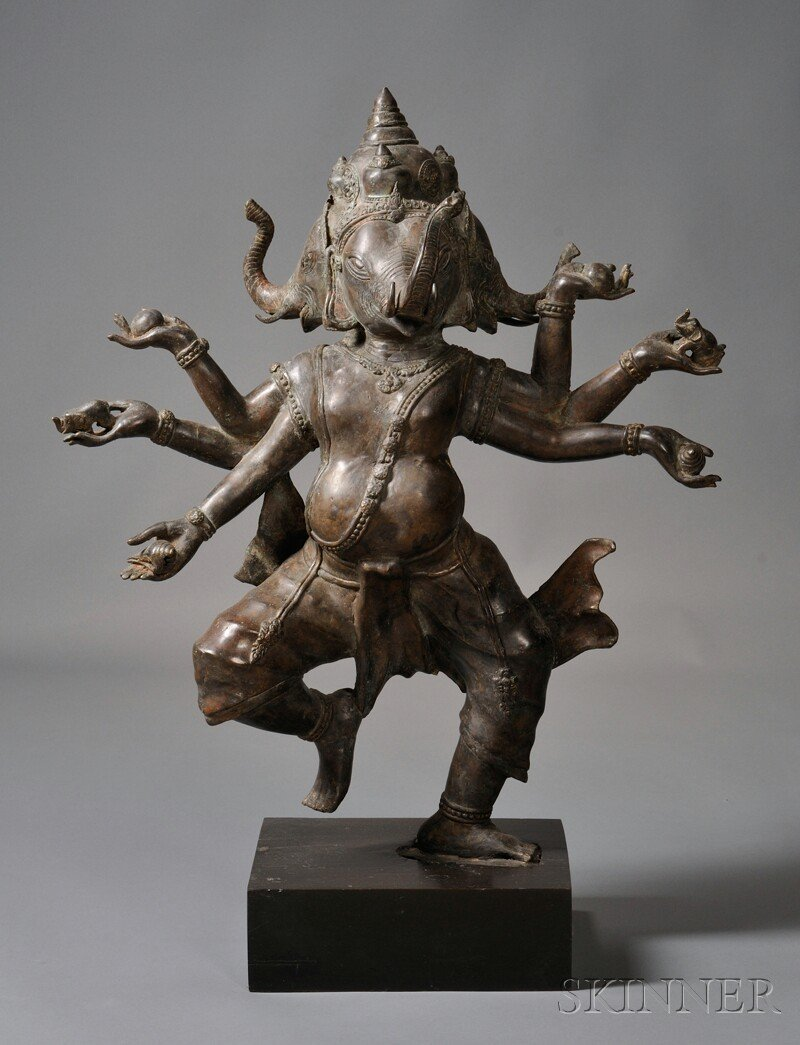 8: Bronze Figure, India, depicting a three-headed Ganes