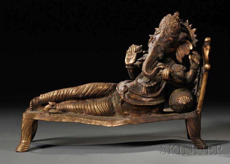 9: Bronze Figurine, India, depicting Ganesha reclining