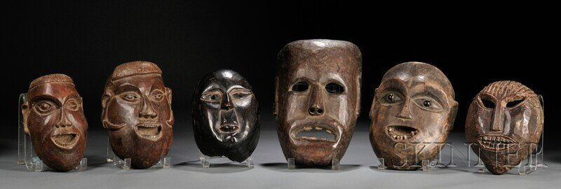 23: Six Carved Wood Masks, Nepal, 20th century, lg. to