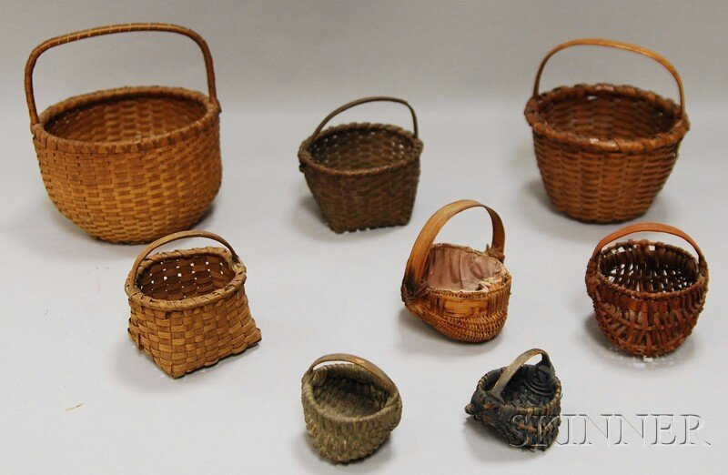 503: Eight Small Woven Splint Baskets, five ribbed bask