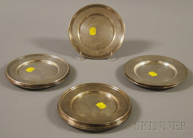 6: Sixteen Sterling Silver Bread Plates, a set of twelv