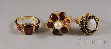 504 Three Gold Gemset Rings a 10kt gold opal and r