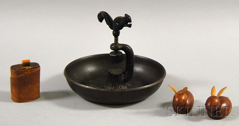 811: Four Decorative Items, a painted cast iron nut bow