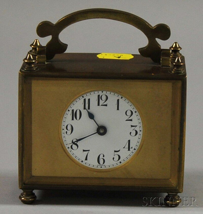 22: French Brass Table Timepiece, both case and movemen