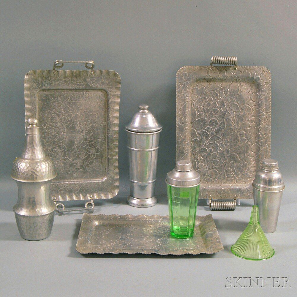 Eight Aluminum and Green Glass Serving Items, two alumi