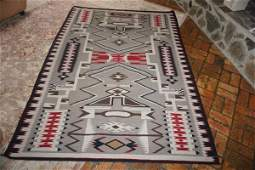 Large Navaho rug in brown, black & red colors, made by