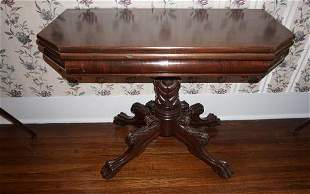 American Classical carved mahogany games table, swivel