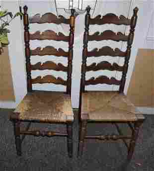 Pair of ladder back chairs with rush seats, carved