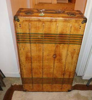 Antique travel trunk by Horn, leather straps, brass