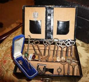 Jewelry box with contents: 14 skeleton keys, 4 sets of