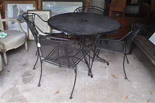 Wrought iron patio set with 4 arm chairs