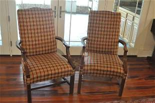 Pair of upholstered arm chairs, mahogany legs, carved