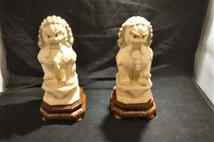 Pair of hand painted & hand carved bone foo dogs on