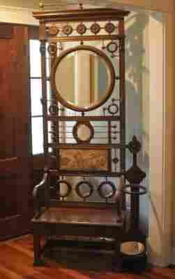 Antique walnut hall tree, ornate top rail, 2 oval