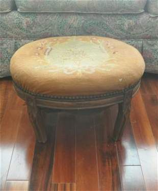 Antique foot stool with needlepoint top, carved legs
