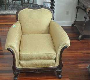 Upholstered arm chair, ornate mahogany crest, curved