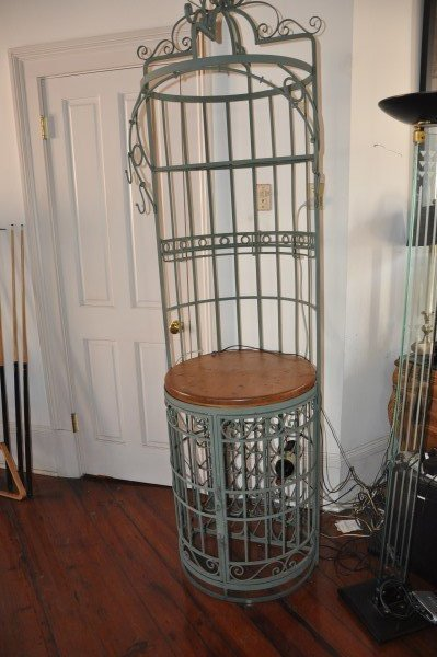 "Wrought iron wine rack, 8' H x 1'11"" round"