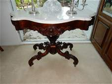 Antique Victorian mahogany turtle top parlor table with