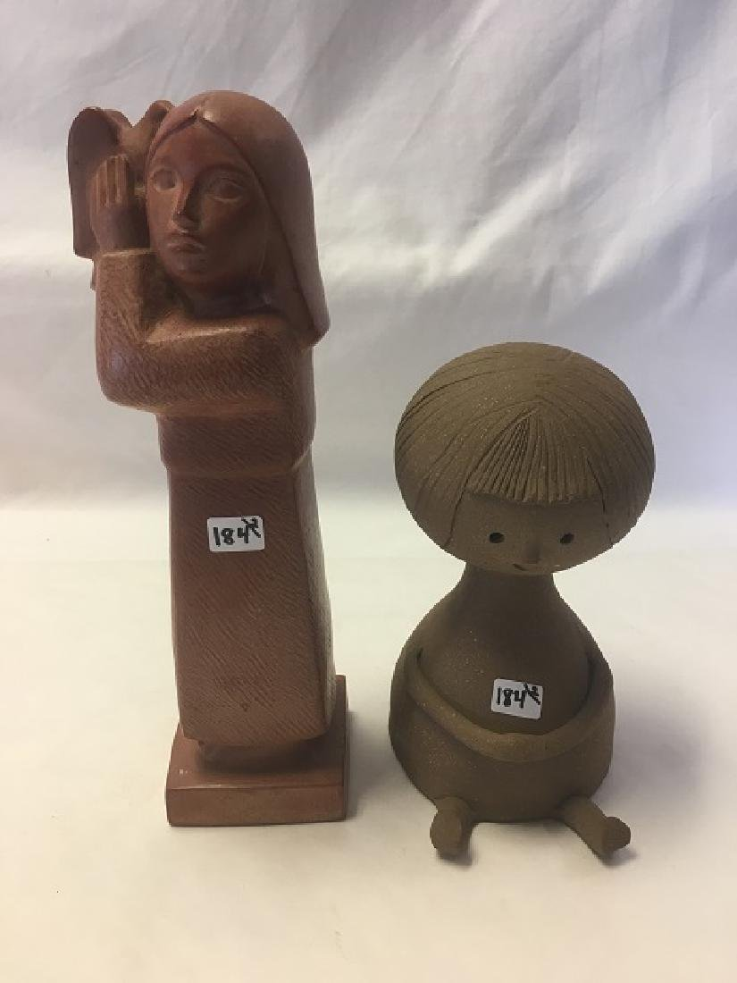 Two Pottery Figures of Young Girls