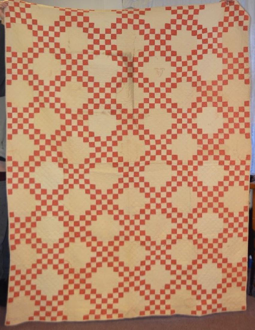 Salmon and Cream Colored Quilt