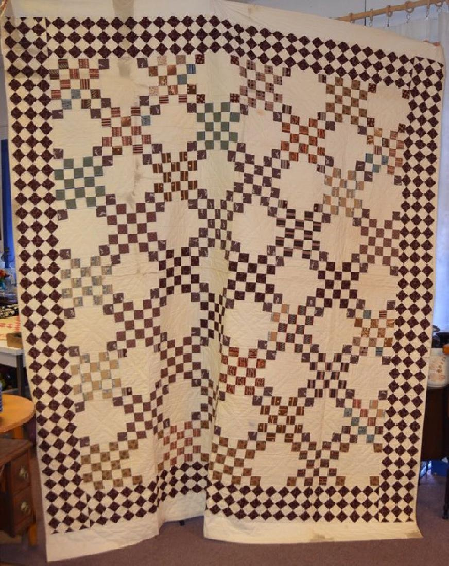 Brown and Cream Colored Quilt