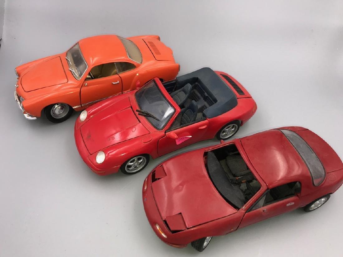 Three 1/18 Scale Model Sports Cars