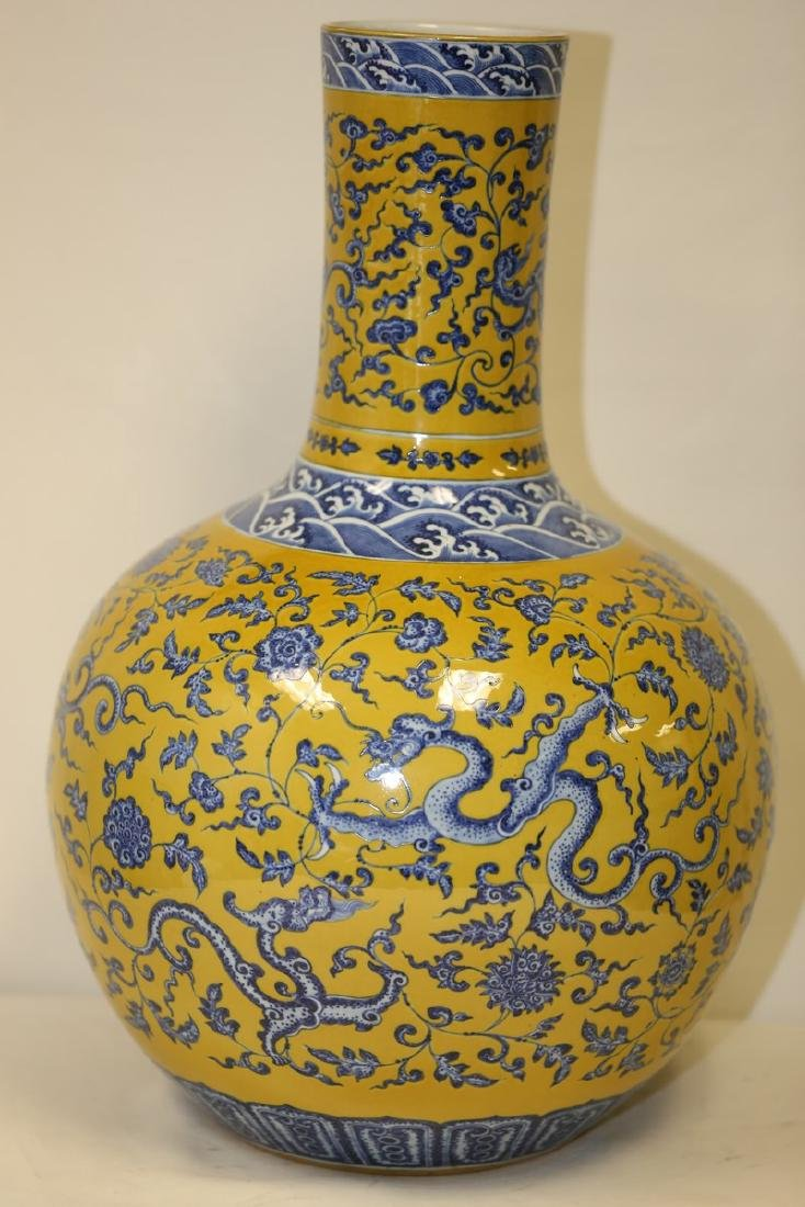 A Large Blue and Yellow Ground Vase