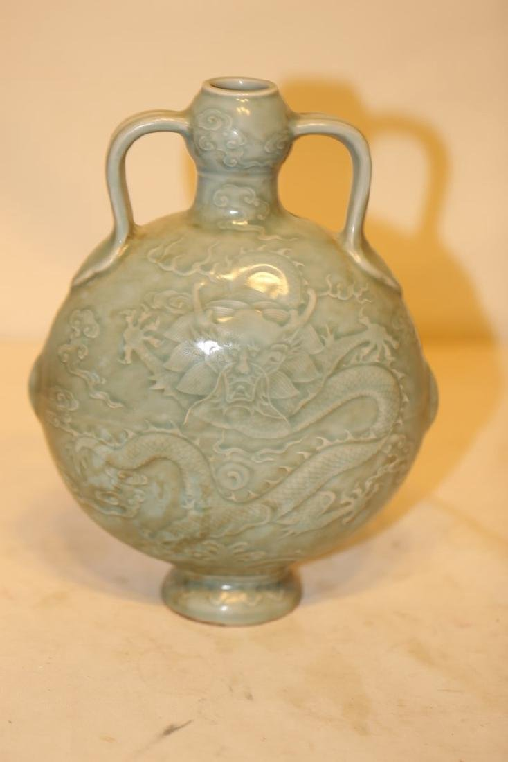 An Excellent Celadon Carved Dragon Moon Flask