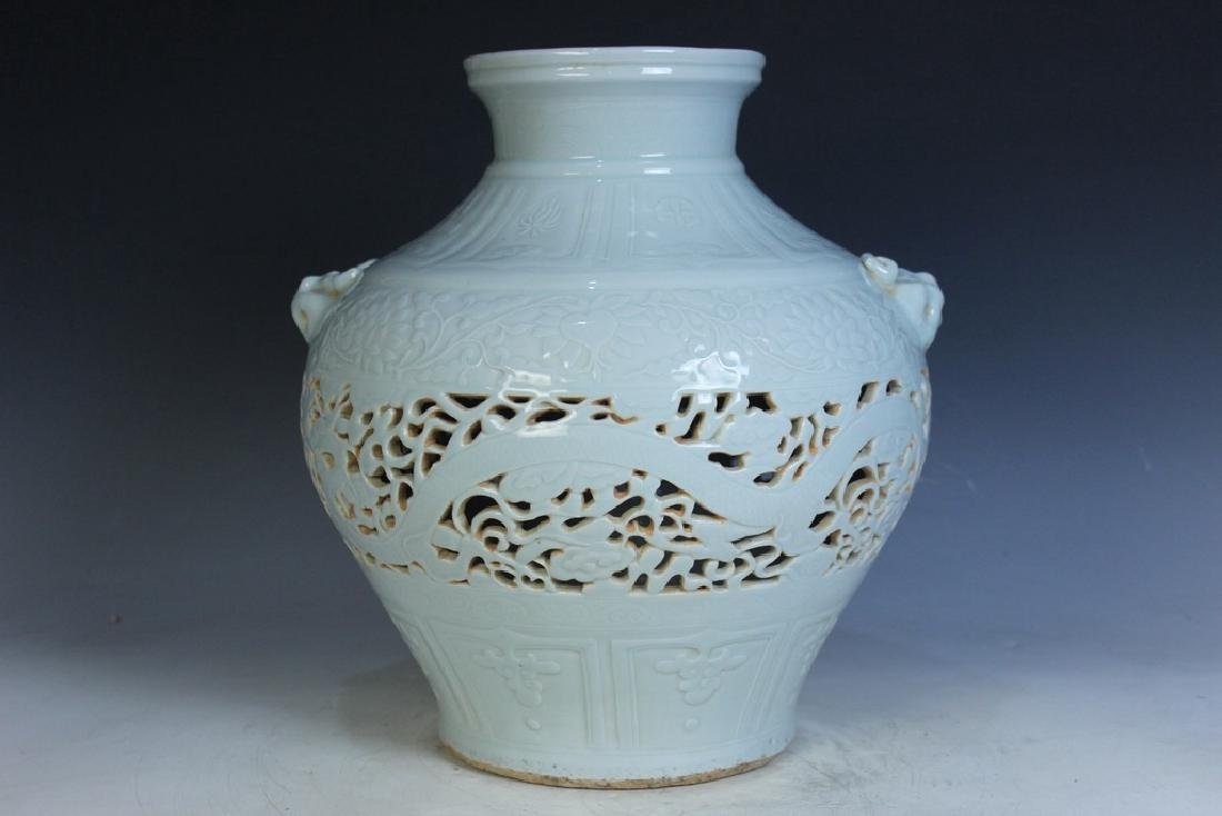 A Celadon Dragon Jar