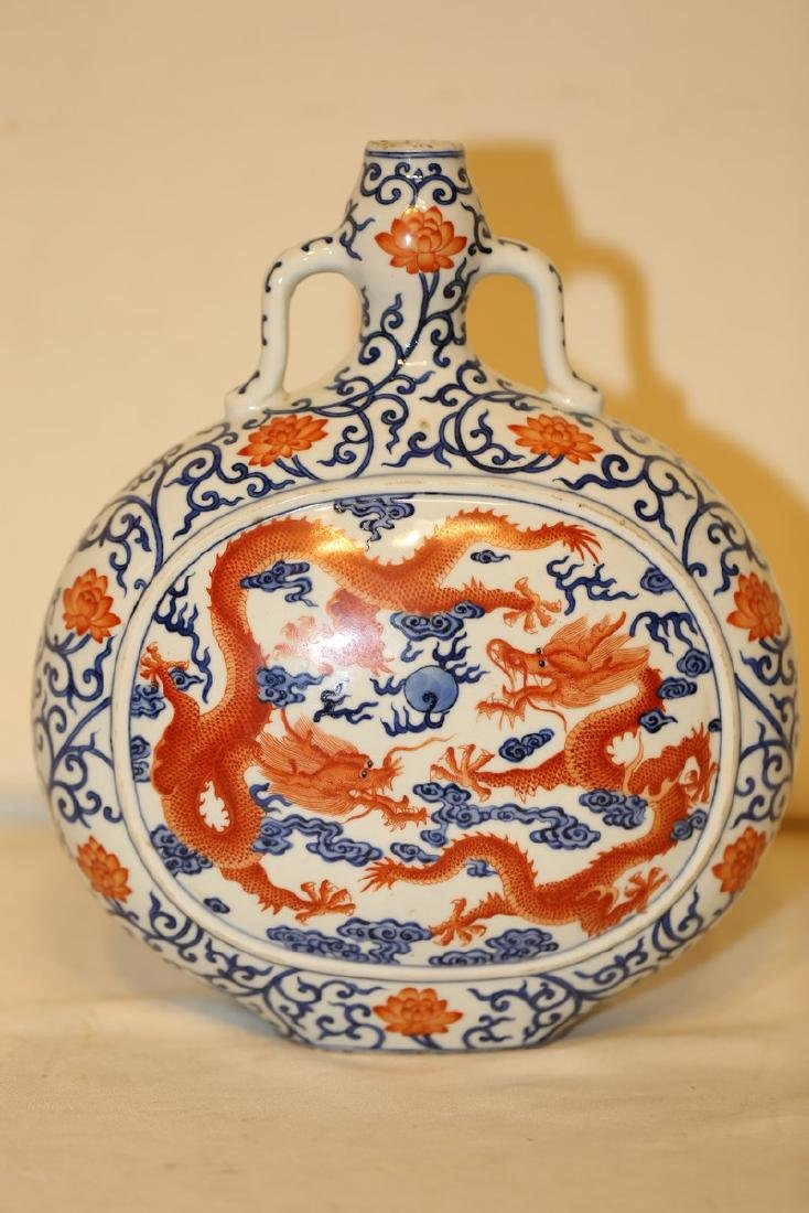 A Blue and White Iron Red Moon Flask - 5