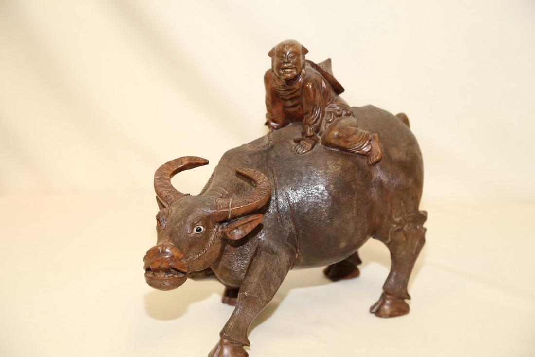 A Hardwood Carving of Boy upon Buffalo