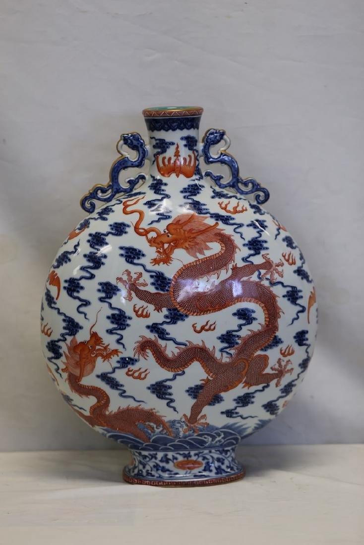 A Blue and White Iron Red Dragon Moon Flask