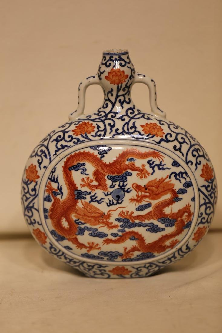 A Blue and White Iron Red Moon Flask
