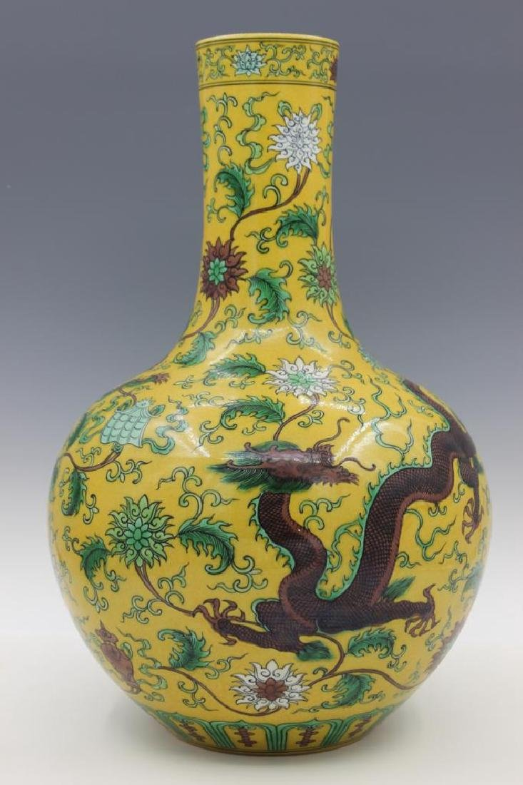 A Very Rare Yellow-Ground Green and Brown Dragon Bottle